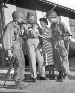 Mr. & Mrs. Hal Bowie and baby daughter Lea. Los Banos Interment Camp survivors, Laguna, Philippines 1945. (A very important picture. Please read below:)