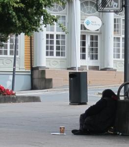 Female_beggar_in_Moss,_Norway